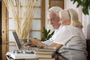 Happy Elderly couple working together